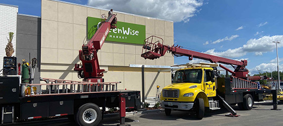 Putting up GreenWise sign